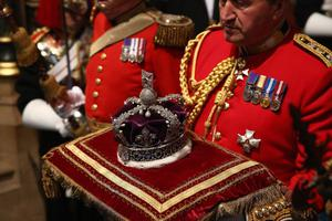 LONDON, ENGLAND - MAY 08: The Imperial State Crown is carried through the Norman Porch of the Palace of Westminster ahead of the State Opening of Parliament on May 8, 2013 in London, England. Queen Elizabeth II unveiled the coalition government's legislative programme in a speech delivered to Members of Parliament and Peers in The House of Lords. Proposed legislation is expected to be introduced on toughening immigration regulations, capping social care costs in England and setting a single state pension rate of 144 GBP per week.  (Photo by Dan Kitwood - WPA Pool/Getty Images)