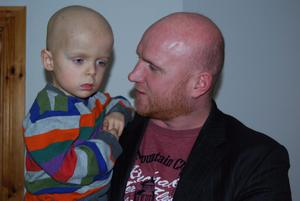 Former Celtic player John Hartson and Oscar Knox