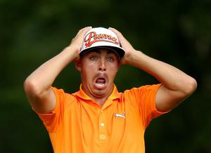 LOUISVILLE, KY - AUGUST 10:  Rickie Fowler of the United States reacts on the fifth tee during the final round of the 96th PGA Championship at Valhalla Golf Club on August 10, 2014 in Louisville, Kentucky.  (Photo by Warren Little/Getty Images)