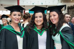 No Fee for Reproduction  Graduating from the Ulster University today with a degree in Buiness are Ashleen Kelly, Aoibhinn Quinn and Carie Mallon from Derry. Picture Martin McKeown. Inpresspics.com. 20.06.15