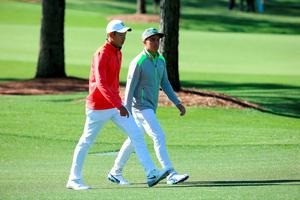 AUGUSTA, GEORGIA - APRIL 07:  Amateur Cheng Jin of China and Rickie Fowler of the United States walk during the first round of the 2016 Masters Tournament at Augusta National Golf Club on April 7, 2016 in Augusta, Georgia.  (Photo by Andrew Redington/Getty Images)