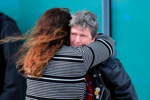 WARRINGTON, ENGLAND - APRIL 26:  Relatives of Hillsborough victims hug as they depart Birchwood Park after hearing the conclusions of the Hillsborough inquest on April 26, 2016 in Warrington, England. The fresh inquests into the 1989 Hillsborough disaster, in which 96 football supporters were crushed to death, concluded on April 26, 2016 with a verdict of unlawful killing, after the initial verdicts were quashed. Relatives of Liverpool supporters who died in Britain's worst sporting disaster gathered in the purpose-built court to hear the jury's verdict in Warrington after a 25 year fight to overturn the accidental death verdicts handed down at the initial 1991 inquiry.  (Photo by Christopher Furlong/Getty Images)