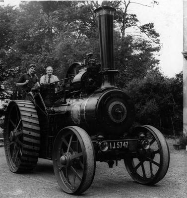 Mr James Wasson, of Carnmoney, and his son Trevor aboard their 1922 single-cylinder traction steam engine.  21/8/1969