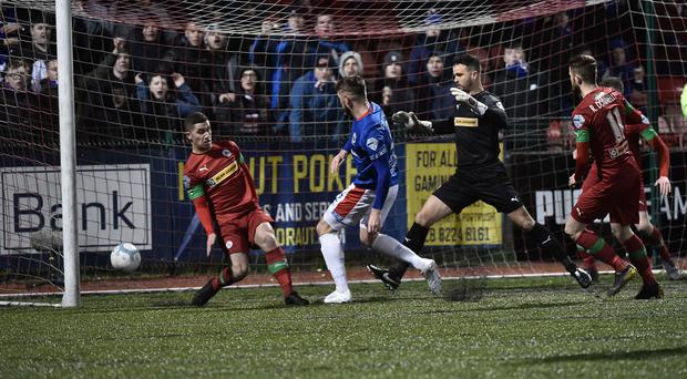 Decisive say: Linfield ace Mark Stafford pokes home the winner at Solitude
