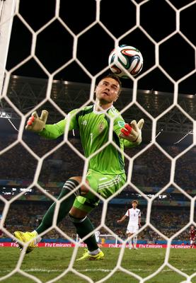 CUIABA, BRAZIL - JUNE 17: Igor Akinfeev of Russia fails to save a shot by Lee Keun-Ho of South Korea (not pictured) for South Korea's first goal during the 2014 FIFA World Cup Brazil Group H match between Russia and South Korea at Arena Pantanal on June 17, 2014 in Cuiaba, Brazil.  (Photo by Warren Little/Getty Images)