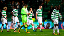 Learning curve: Celtic players dejected after getting mauled by PSG at Parkhead last night