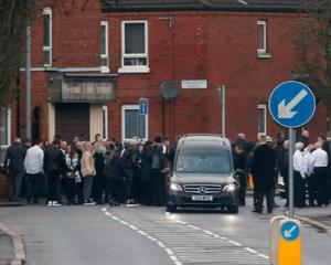 The gathering at the funeral of loyalist Hugh 'Boot' Hill