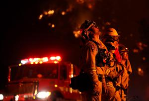 CLEARLAKE, CA - AUGUST 02:  Cal Fire firefighters monitor a backfire ahead of the Rocky Fire on August 2, 2015 near Clearlake, California. Over 1,900 firefighters are battling the Rocky Fire that burned over 22,000 acres since it started on Wednesday afternoon. The fire is currently five percent contained and has destroyed at least 14 homes.  (Photo by Justin Sullivan/Getty Images)
