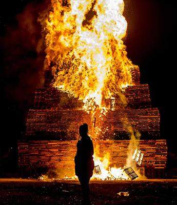 The 'eleventh night' bonfire is lit at the Milner Street area of the Village in South Belfast as celebrations of William of Orange's victory commence on July 11th 2017 (Photo by Kevin Scott / Belfast Telegraph)