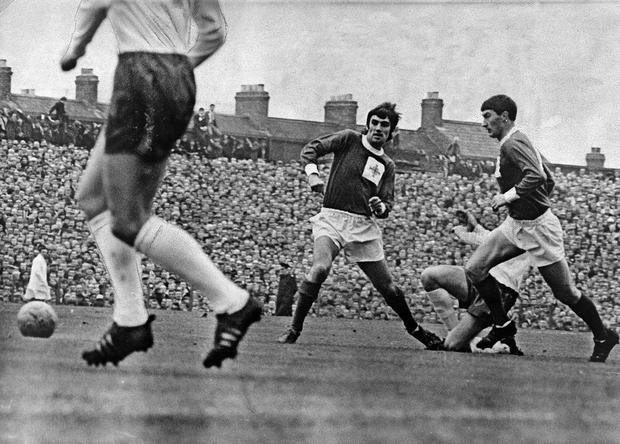George Best. Football. Manchester United and Northern Ireland. Ireland v England Oct. 1966. Best and Parke outwitted by a headless Charlton as Englend mount an attack.