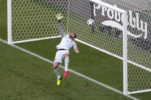 Portugal goalkeeper Rui Patricio fails to stop a shot from Hungary's Balazs Dzsudzsak scoring his side's 2nd goal during the Euro 2016 Group F soccer match between Hungary and Portugal at the Grand Stade in Decines-Charpieu, near Lyon, France, Wednesday, June 22, 2016. (AP Photo/Michael Sohn)
