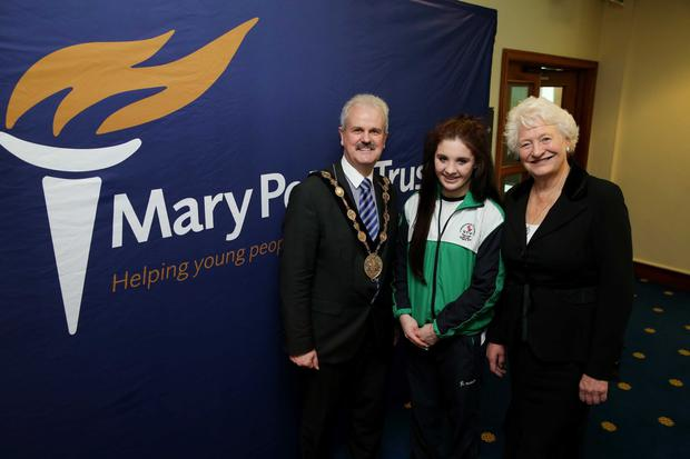 Pictured with the Mayor of Lisburn & Castlereagh City Council, Councillor Thomas Beckett at the launch of his Mayoral Charity, Mary Peters Trust are: Rachel Bethel, Commonwealth Games Swimmer, a local athlete and previous recipient of a grant from the Trust; and Dame Mary Peters CH DBE.