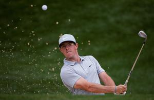 Rory McIlroy, of Northern Ireland, hits out of the bunker on the 12th hole during the second round of the PGA Championship golf tournament at Valhalla Golf Club on Friday, Aug. 8, 2014, in Louisville, Ky. (AP Photo/David J. Phillip)