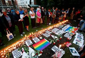 People laying candles and floral tributes at Saint Anne's Church in Soho, London, following a vigil for the victims of the Orlando Shootings at a Gay nightclub in Florida.  Yui Mok/PA Wire
