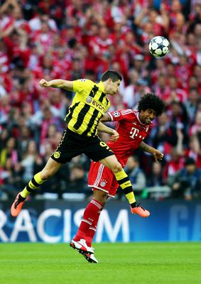 LONDON, ENGLAND - MAY 25:  Robert Lewandowski of Borussia Dortmund (L) in action with Dante of Bayern Muenchen during the UEFA Champions League final match between Borussia Dortmund and FC Bayern Muenchen at Wembley Stadium on May 25, 2013 in London, United Kingdom.  (Photo by Alex Grimm/Getty Images)