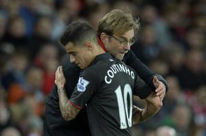 Liverpool's German manager Jurgen Klopp (R) hugs Liverpool's Brazilian midfielder Philippe Coutinho (L) as Coutinho leaves the field after being substituted during the English Premier League football match between Sunderland and Liverpool at the Stadium of Light in Sunderland, north east England, on December 30, 2015. AFP PHOTO / OLI SCARFF  RESTRICTED TO EDITORIAL USE. No use with unauthorized audio, video, data, fixture lists, club/league logos or 'live' services. Online in-match use limited to 75 images, no video emulation. No use in betting, games or single club/league/player publications.OLI SCARFF/AFP/Getty Images