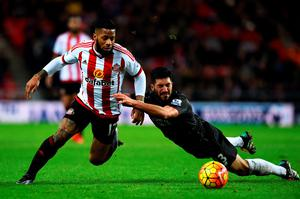 SUNDERLAND, ENGLAND - DECEMBER 30:  Jeremain Lens of Sunderland battles for the ball with Emre Can of Liverpool during the Barclays Premier League match between Sunderland and Liverpool at Stadium of Light on December 30, 2015 in Sunderland, England.  (Photo by Stu Forster/Getty Images)