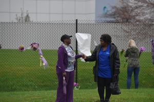 CHANHASSEN, MN - APRIL 21: Teia Buroton,  a Paisley Park volunteer, consoles a mourner outside Prince's home on April 21, 2016 in Chanhassen, Minnesota. Prince died earlier today at his Paisley Park compound at the age of 57.  (Photo by Jules Ameel/Getty Images)