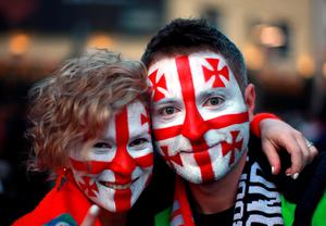 Georgia fans with face paint before the Rugby World Cup match at the Millennium Stadium, Cardiff. PRESS ASSOCIATION Photo. Picture date: Friday October 2, 2015. See PA story RUGBYU New Zealand. Photo credit should read: David Davies/PA Wire. RESTRICTIONS: Use subject to restrictions. Editorial use only. No commercial use. No use in books or print sales without prior permission. Call +44 (0)1158 447447 for further information.
