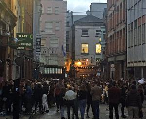 People out in Dublin on Saturday evening as lockdown restrictions start to ease. (Gaillot et Gray/Twitter/PA)