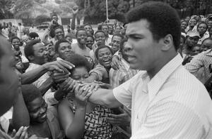 In this Sept. 17, 1974, file photo, Muhammad Ali is greeted in downtown Kinshasa, Zaire. Ali is in Zaire to fight George Foreman. Ali, the magnificent heavyweight champion whose fast fists and irrepressible personality transcended sports and captivated the world, has died according to a statement released by his family Friday, June 3, 2016. He was 74. (AP Photo)