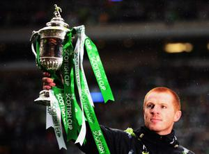 GLASGOW, SCOTLAND - MAY 21:  Celtic Manager Neil Lennon celebrates with his team after winning the Scottish Cup Final between Celtic and Motherwell at Hampden Park on May 21, 2011 in Glasgow, Scotland.  (Photo by Bryn Lennon/Getty Images)