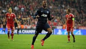 Manchester United's Patrice Evra celebrates after scoring his side's first goal during the Champions League, Quarter Final, Second Leg at the Allianz Arena, Munich, Germany.