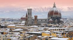 Beautiful winter cityscape of Florence with Cathedral of Santa Maria del Fiore on the background, as seen from Piazzale Michelangelo. Italy.