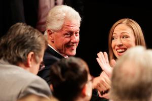 LAS VEGAS, NV - OCTOBER 19:  Former U.S. President Bill Clinton and his daughter Chelsea Clinton speak to guests before the start of the third U.S. presidential debate at the Thomas & Mack Center on October 19, 2016 in Las Vegas, Nevada. Tonight is the final debate ahead of Election Day on November 8.  (Photo by Chip Somodevilla/Getty Images)