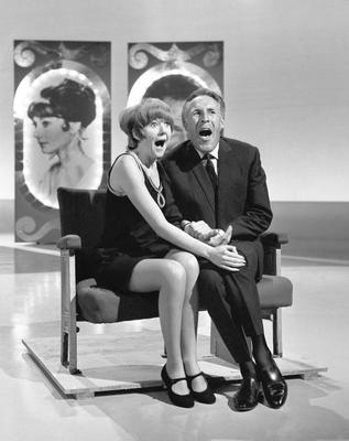 Cilla Black and Bruce Forsyth record a sketch for a Christmas show at ABC-TV's studios in Teddington in 1965.