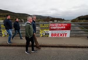 TD Gerry Adams (right) at a Border Communities Against Brexit protest on Old Belfast Road in Carrickcarnon on the northern side of the Irish border, between Newry and Dundalk. The day of protest is against a hard border in Ireland. PRESS ASSOCIATION Photo. Picture date: Saturday March 30, 2019. See PA story POLITICS Brexit. Photo credit should read: Niall Carson/PA Wire