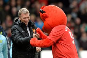 Manchester United's manager David Moyes with mascot Fred the Red before the Capital One Cup, Fourth Round match at Old Trafford, Manchester.