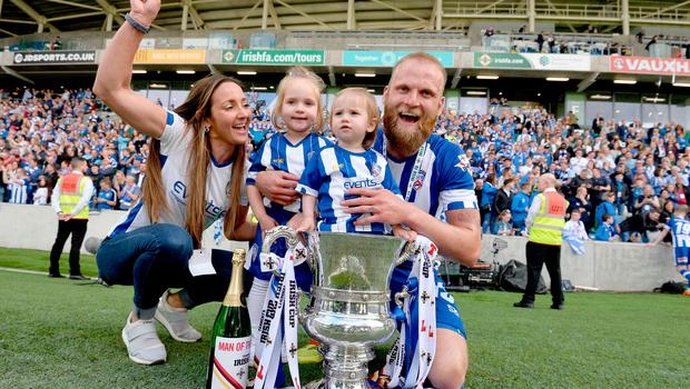 Family affair: Coleraine hero Gareth McConaghie celebrates with his family after the Irish Cup triumph