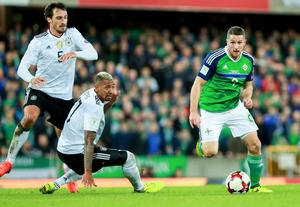 Northern Ireland's Conor Washington and Germany's Matts Hummells and Jerome Boateng in action during the World Cup Qualifier at Windsor Park in Belfast on October 4th 2017 (Photo by Kevin Scott / Belfast Telegraph)