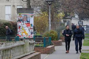 Police officers patrol near a pre-school, after a masked assailant with a box-cutter and scissors who mentioned the Islamic State group attacked a teacher, Monday, Dec.14, 2015 in Paris suburb Aubervilliers. The assailant remains at large, and the motive for the attack in the town of Aubervilliers is unclear, authorities said. (AP Photo/Michel Euler)