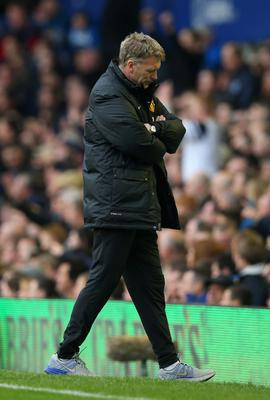 LIVERPOOL, ENGLAND - APRIL 20:  A dejected David Moyes manager of Manchester United looks to the ground during the Barclays Premier League match between Everton and Manchester United at Goodison Park on April 20, 2014 in Liverpool, England.  (Photo by Clive Brunskill/Getty Images)