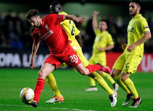 Liverpool's midfielder Adam Lallana (L) vies with Villarreal's Ivorian defender Eric Bally (2nd L) during the UEFA Europa League semifinals first leg football match Villarreal CF vs Liverpool FC at El Madrigal stadium in Vila-real on April 28, 2016. / AFP PHOTO / JOSE JORDANJOSE JORDAN/AFP/Getty Images