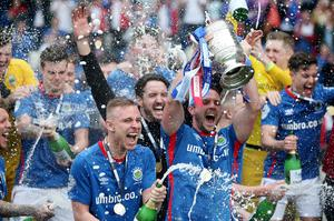 Linfield captain Jamie Mulgrew lifts the Gibson Cup after his side became Danske Bank Premiership Champions in 2019