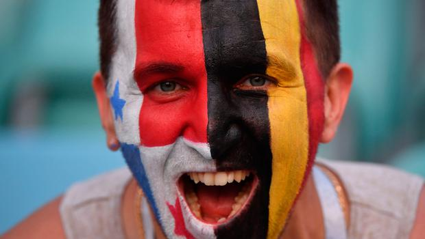 TOPSHOT - A fan with the face painted half like the Panama's flag and the other half like the Belgian flag cheers prior to the Russia 2018 World Cup Group G football match between Belgium and Panama at the Fisht Stadium in Sochi on June 18, 2018. / AFP PHOTO / Nelson Almeida / RESTRICTED TO EDITORIAL USE - NO MOBILE PUSH ALERTS/DOWNLOADSNELSON ALMEIDA/AFP/Getty Images