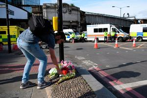A man lays flowers on London Bridge after it was reopened following the June 3rd terror attack on June 5, 2017 in London, England. Seven people were killed and at least 48 injured in terror attacks on London Bridge and Borough Market. Three attackers were shot dead by armed police.  (Photo by Leon Neal/Getty Images)