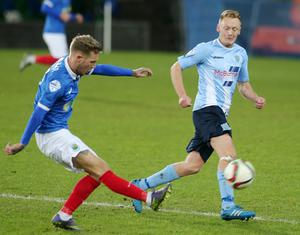 Press Eye - Belfast - Northern Ireland - 12th January 2016  Toals Bookmakers County Antrim Shield Final at Windsor Park Belfast.  Linfield Vs Ballymena.  Linfield's Kirk Millar with Ballymena's Stephen McBride.  Picture by Jonathan Porter/PressEye