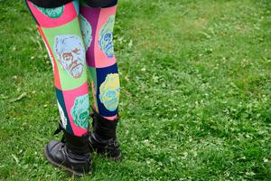 A supporter wears a pair of Jeremy Corbyn decorated tights at a general election campaign event in Birmingham, central England, on June 6, 2017. Britain goes to the polls on June 8 to vote in a general election only days after another deadly terror attack in the nation's captial. / AFP PHOTO / Paul ELLISPAUL ELLIS/AFP/Getty Images