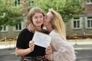 Pacemaker Press 20-08-2020:  Student Emma Bernadette Agnew pictured with mum Julie celebrating GCSE success at St Dominic's Grammar School Belfast .There has been a significant rise in the number of top GCSE grades in Northern Ireland. Grades A*-A were awarded to 37.1% of entries, up from just under a third of entries in 2019. Picture By: Arthur Allison/ Pacemaker Press.