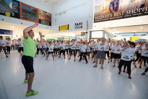Press Eye - Belfast -  Northern Ireland - 24th June 2015 - Athletes warm up with Fitness Freddie to take part in the first ever Grant Thornton Runway Run at Belfast City Airport this evening. Picture by Kelvin Boyes / Press Eye.