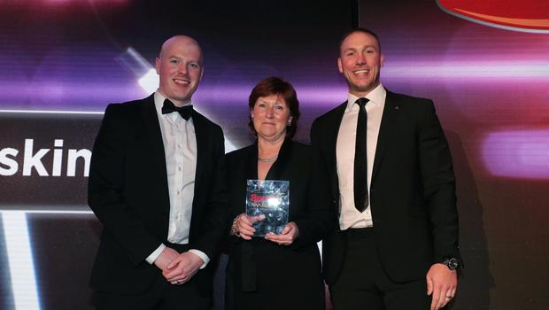 Press Eye - Belfast - Northern Ireland - 20th January  2020  Photo by Kelvin Boyes / Press Eye.  2019 Belfast Telegraph Sport Awards at the Crowne Plaza Hotel in Belfast.   AWARD 16  SPECIAL RECOGNITION AWARD sponsored by Linwoods  Peter Woods, Director, Linwoods and Stephen Ferris make a presentation to Wilma Erskine.