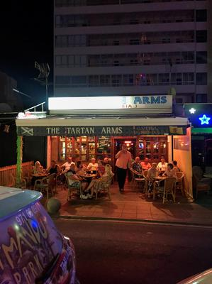 Tourists on the Punta Ballena strip in Magaluf, Spain, as the town saw tough new rules cracking down on drunkenness come into force at midnight