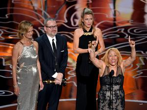 HOLLYWOOD, CA - MARCH 02:  (L-R) Janet Friesen, director Morgan Neville, producer Caitrin Rogers, and singer Darlene Love accept the Best Documentary, Feature award for '20 Feet from Stardom' onstage during the Oscars at the Dolby Theatre on March 2, 2014 in Hollywood, California.  (Photo by Kevin Winter/Getty Images)