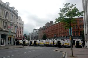 PSNI vehicles on Royal Avenue, Belfast, as a major security operation is under way in the city centre ahead of the contentious republican parade and related loyalist protests. David Young/PA Wire.