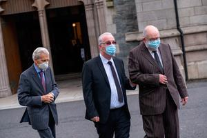 Richard Moore (centre), the founder of Children in Crossfire, arrives for the funeral of John Hume at St Eugene's Cathedral in Londonderry. PA Photo. Picture date: Wednesday August 5, 2020. Hume was a key architect of Northern Ireland's Good Friday Agreement and was awarded the Nobel Peace Prize for the pivotal role he played in ending the region's sectarian conflict. He died on Monday aged 83, having endured a long battle with dementia. See PA story FUNERAL Hume. Photo credit should read: Stephen Latimer/PA Wire