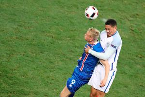(LtoR) Iceland's forward Kolbeinn Sigthorsson and England's defender Chris Smalling vie for the ball during the Euro 2016 round of 16 football match between England and Iceland at the Allianz Riviera stadium in Nice on June 27, 2016. / AFP PHOTO / Valery HACHEVALERY HACHE/AFP/Getty Images